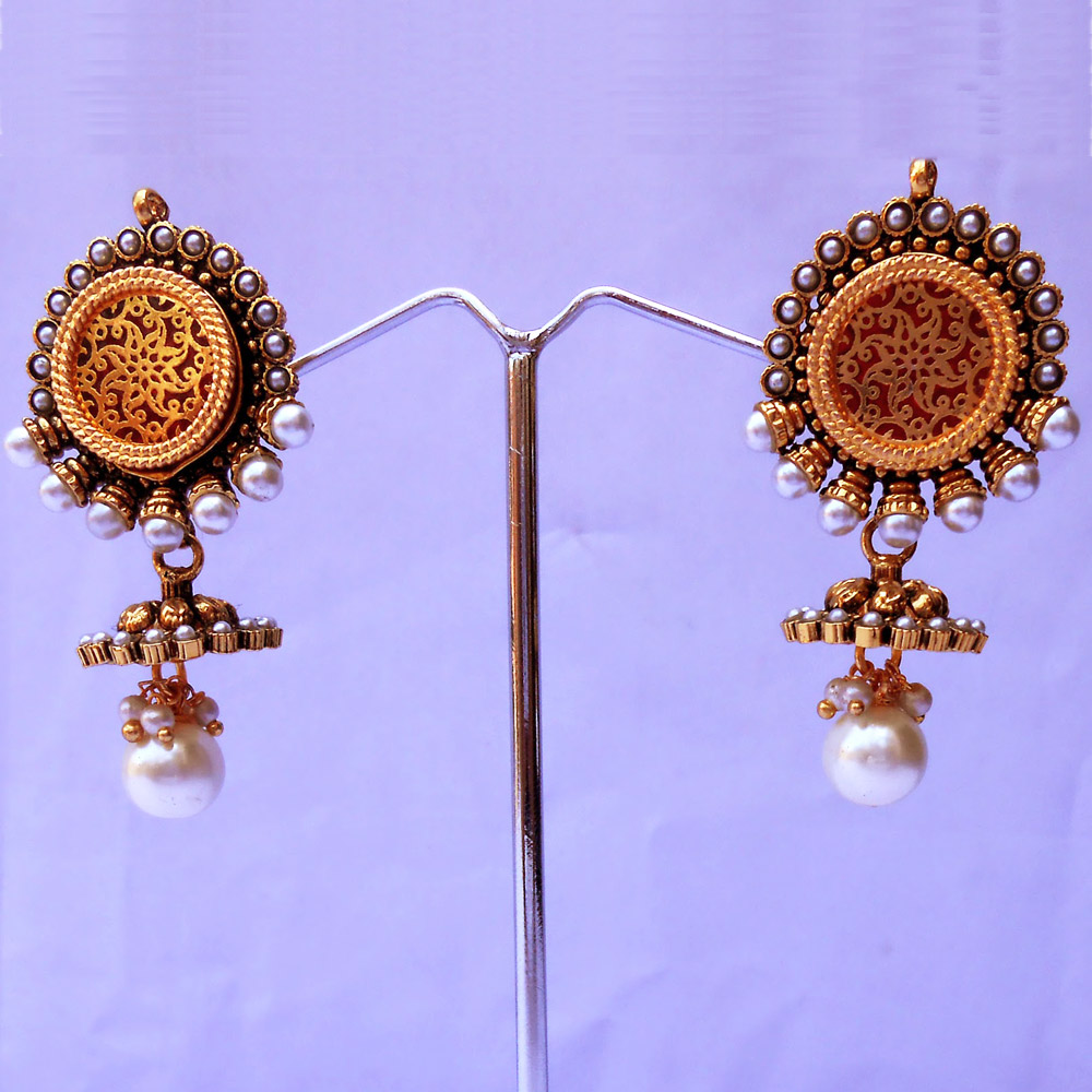 Jhumka earrings embedded with pearls