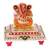 Marble ganesh idol sitting on chowki