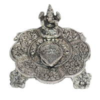 Silver coloured oxidised Ganesh chowki with diya